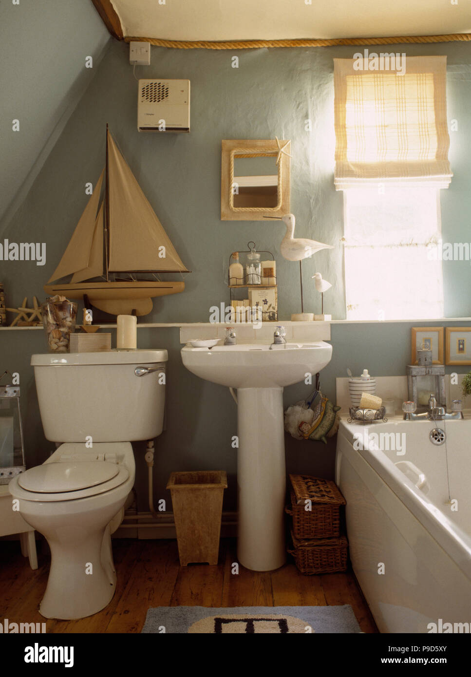Model Sailing Boat On Shelf Above Toilet And White Pedestal Basin In  Blue Grey Cottage Bathroom With Cream Blind