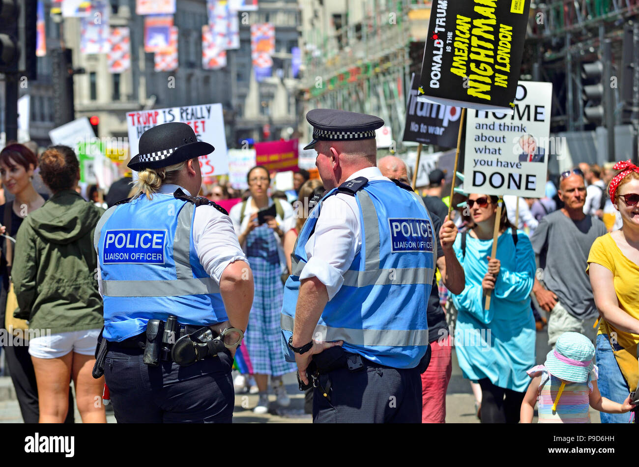 Metropolitan Police Liaison Officers at an anti-Trump march in central London, England, UK. 13th July 2018 Stock Photo