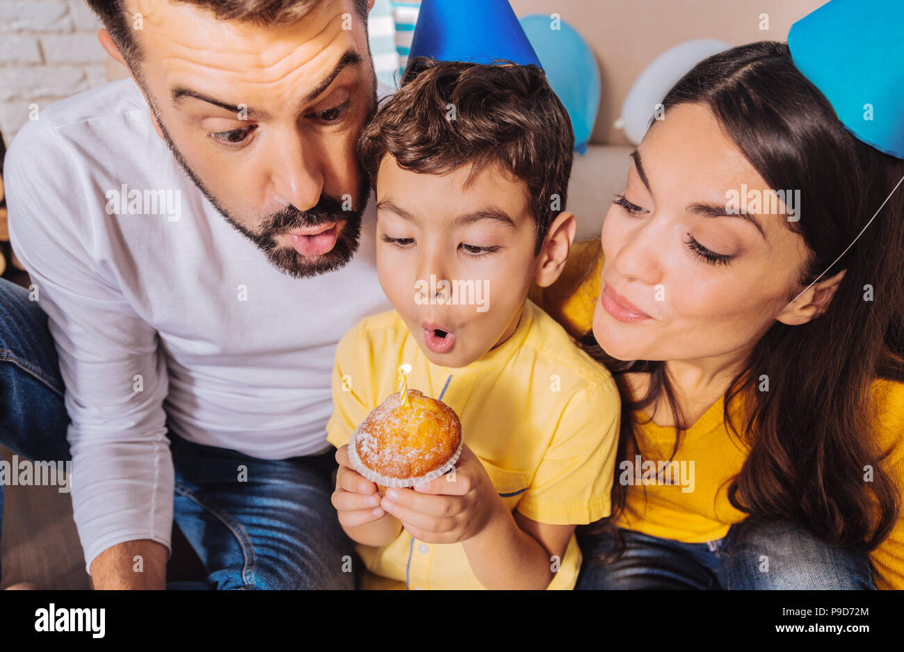 Close up of attentive boy that making wish - Stock Image