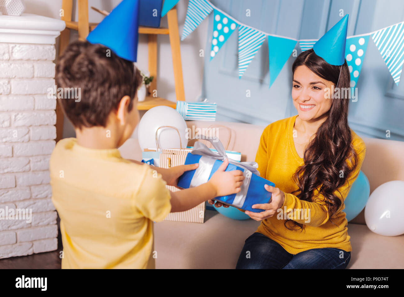 Pleased mommy having birthday party - Stock Image