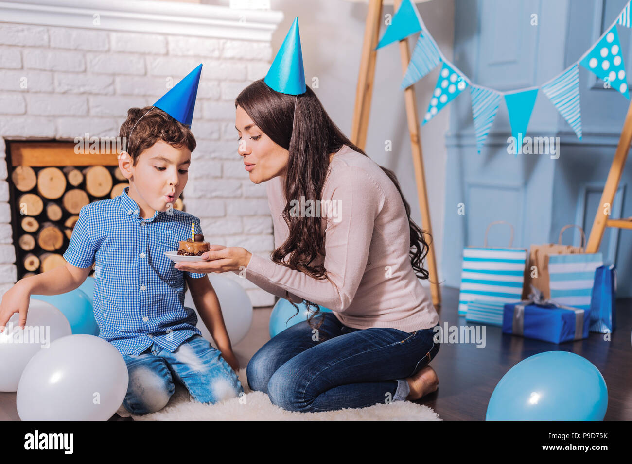 Attentive female person holding plate with cake - Stock Image