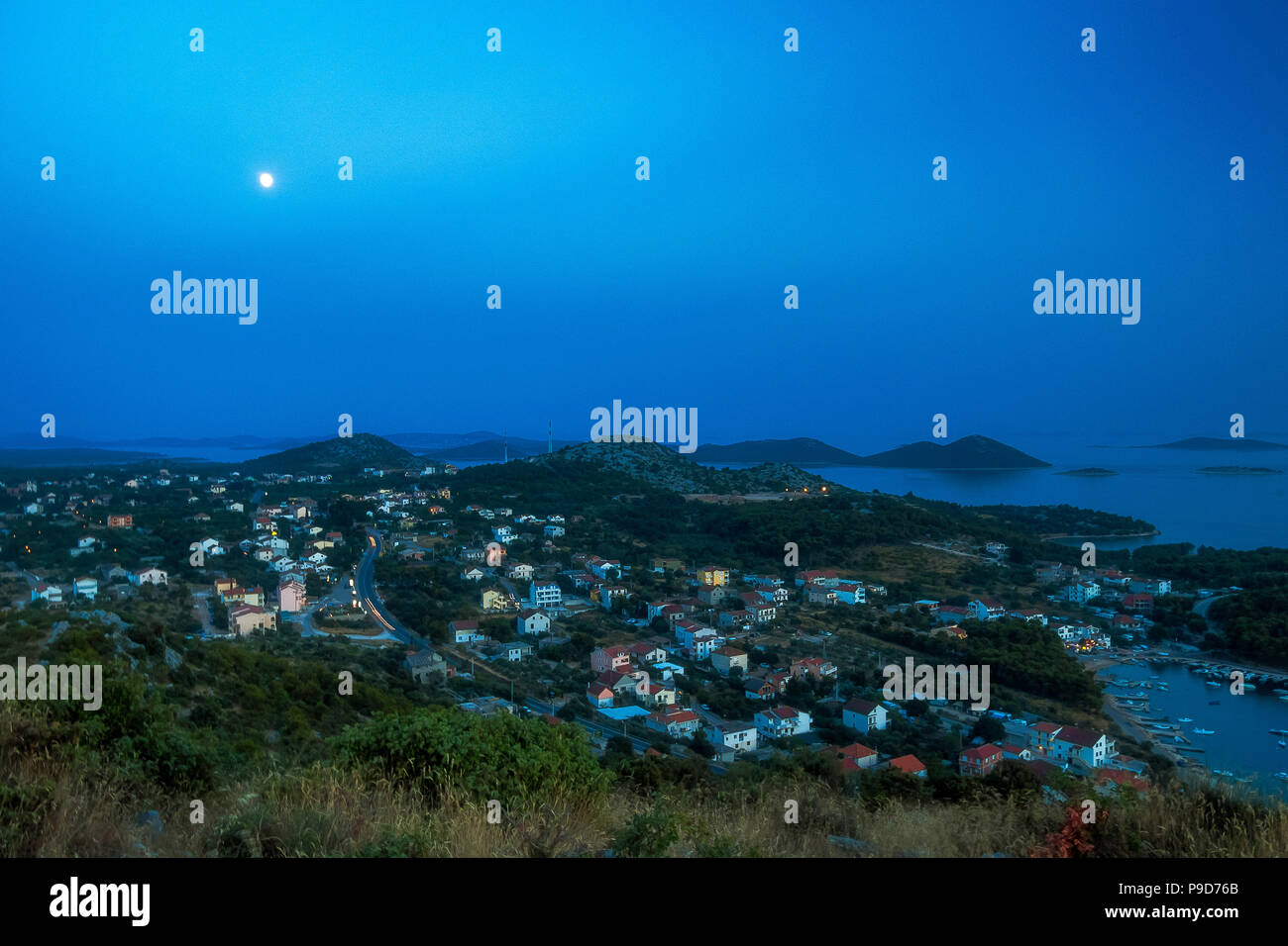 Amazing Kornati archipelago of Croatia. Northern part of Dalmatia. Sunny detail of Drage town. Beautiful night seascape with moon from Zadar to Sibeni - Stock Image