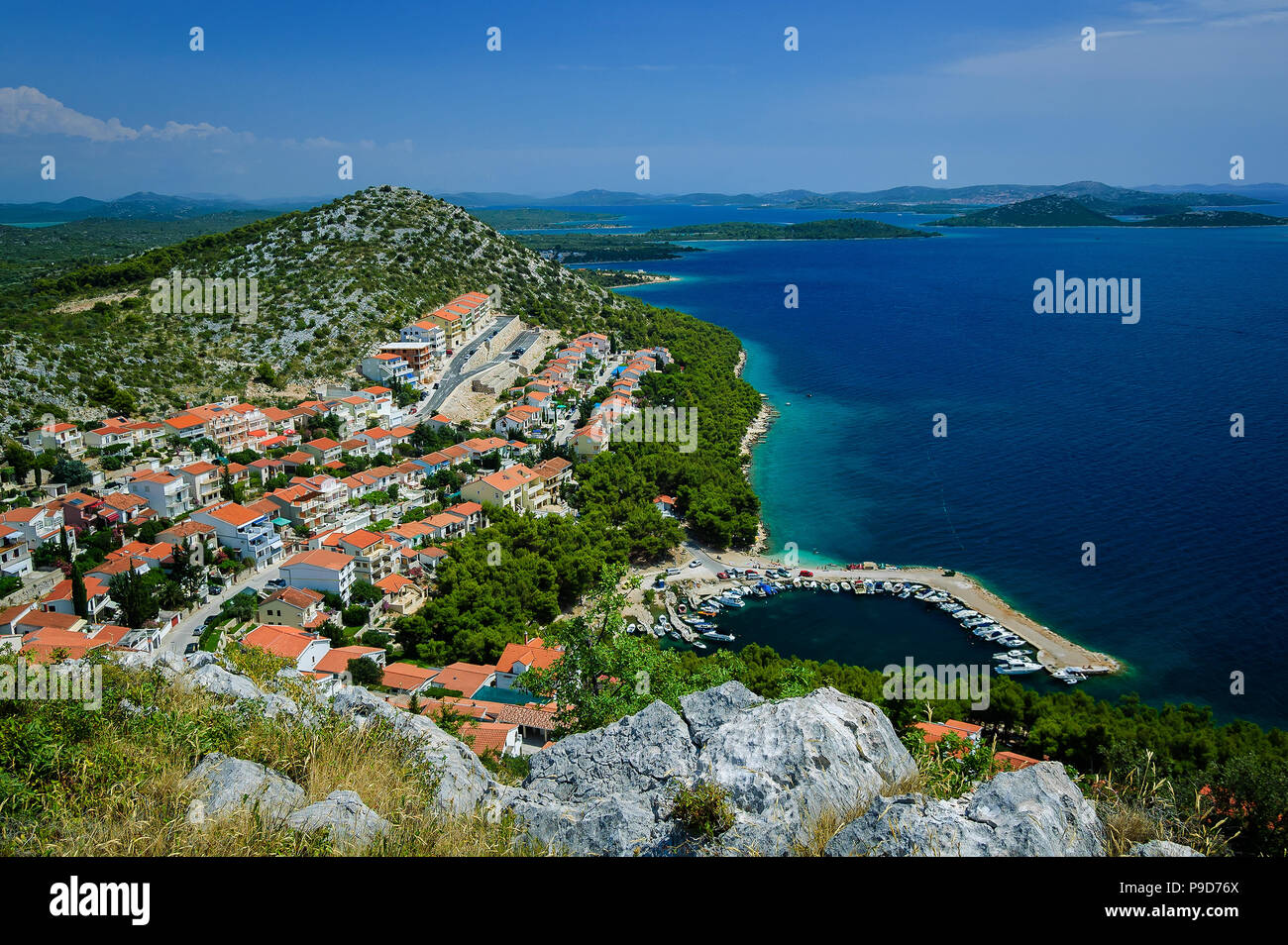 Amazing Kornati archipelago of Croatia. Northern part of Dalmatia. Sunny detail of Drage town. Beautiful summer seascape with clear water from Zadar t - Stock Image