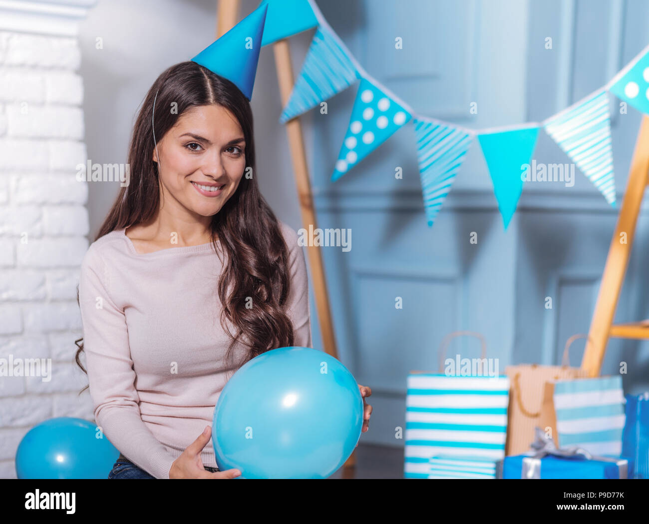 Cheerful girl having birthday party - Stock Image