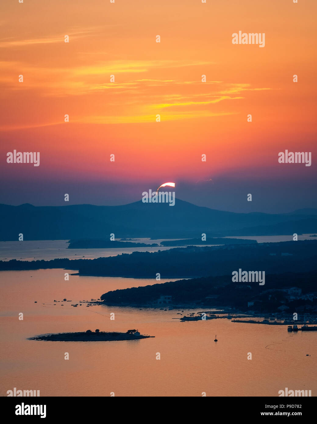 Amazing Kornati archipelago of Croatia. Northern part of Dalmatia. Sunny detail of Stomorski islands. Beautiful sunset view with clear water from Zada - Stock Image