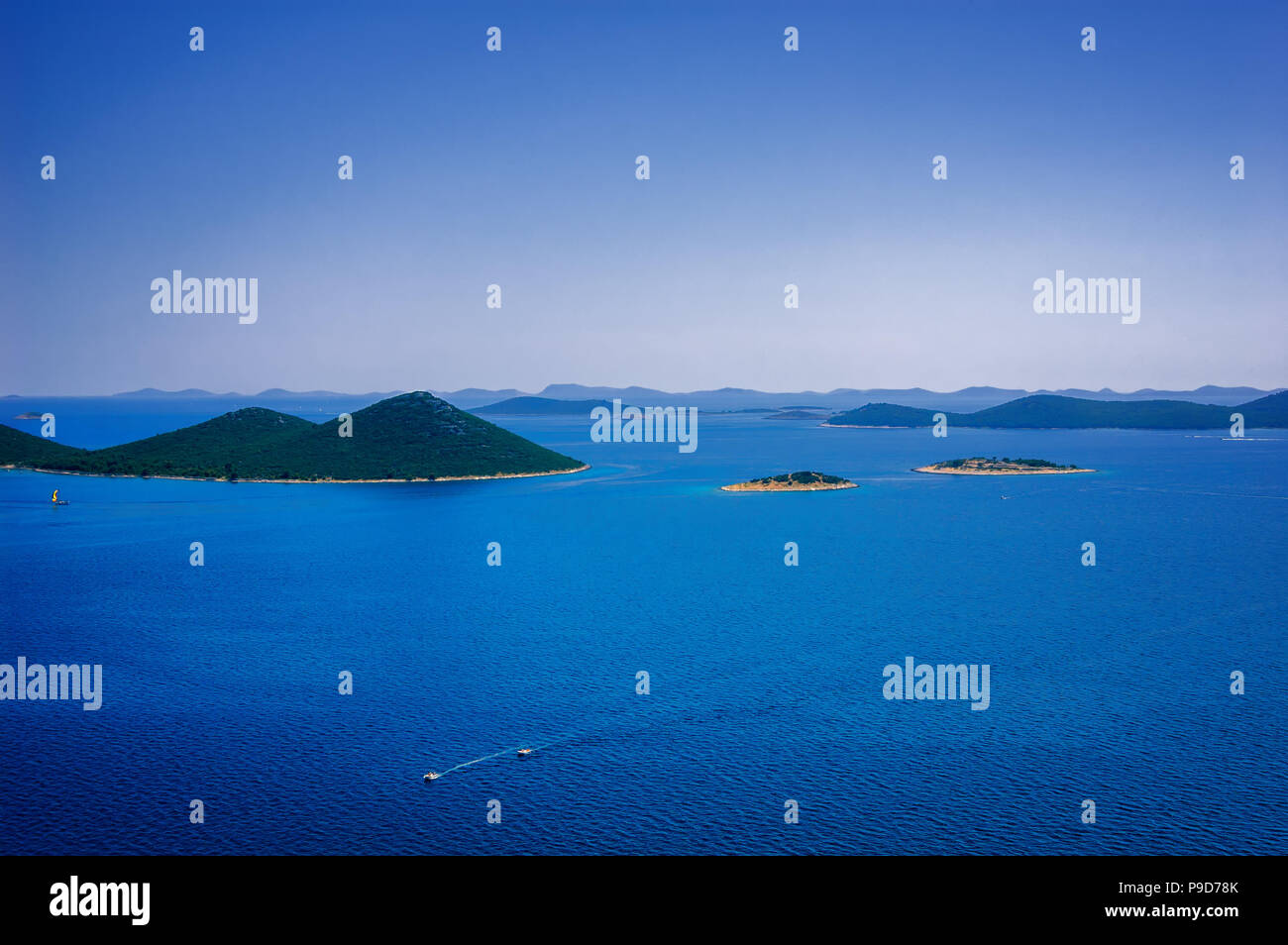 Amazing Kornati archipelago of Croatia. Northern part of Dalmatia. Sunny detail of Stomorski islands. Beautiful summer seascape with clear water from  - Stock Image