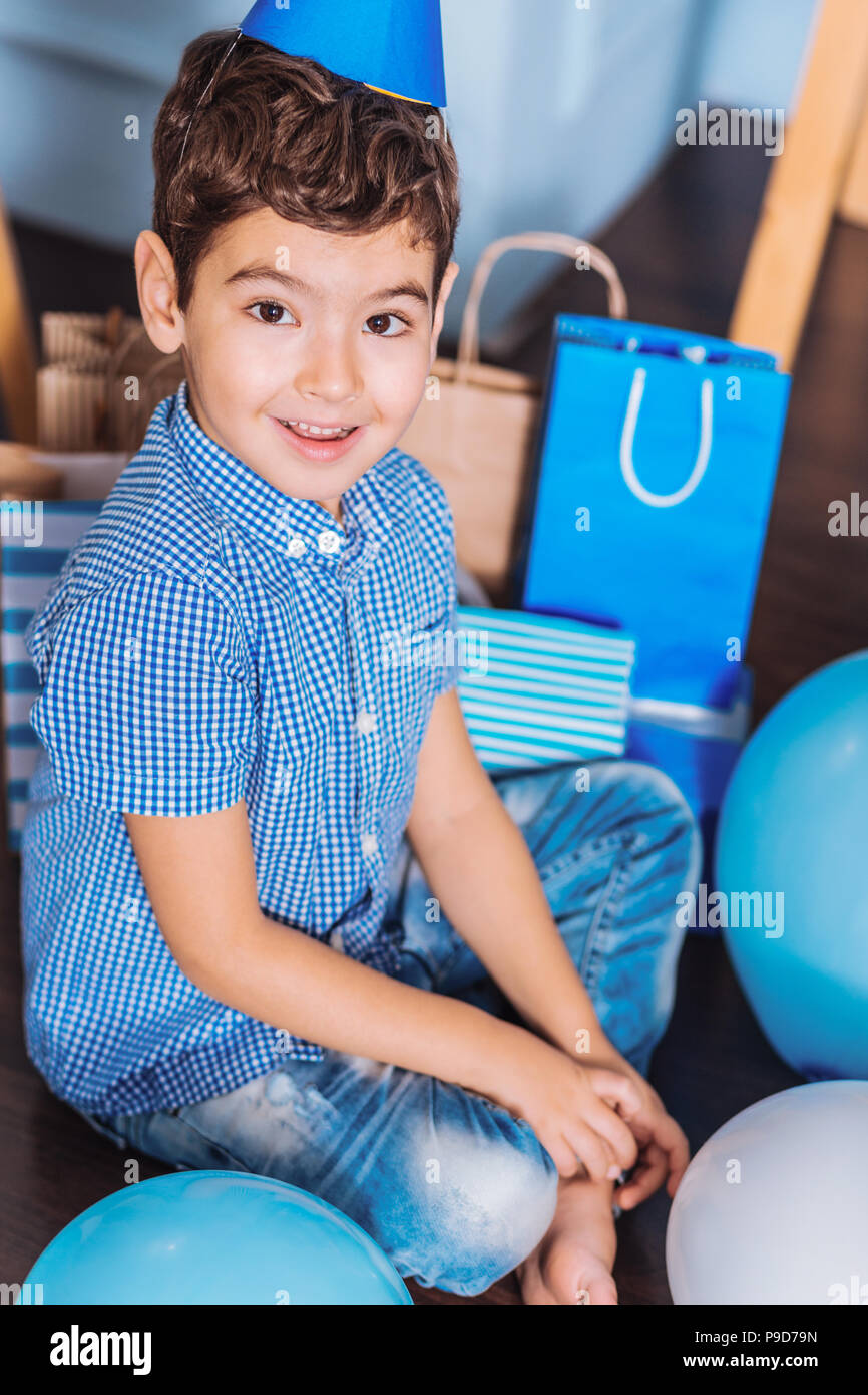 Emotional kid having birthday party - Stock Image