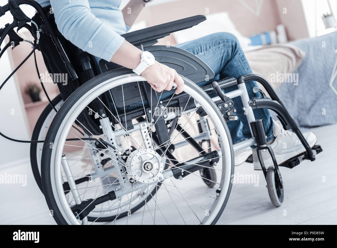 Focused photo on female hand that touching wheel - Stock Image