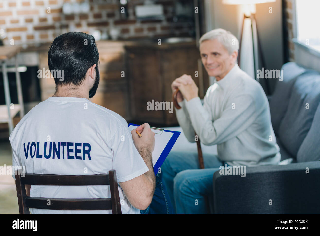 Inspired volunteer conducting a poll - Stock Image