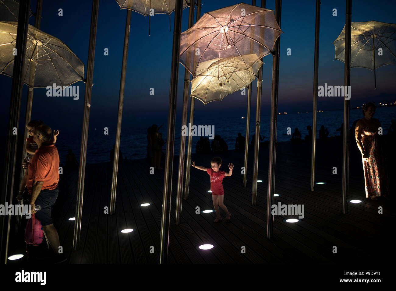 People photographed in Zongolopoulos umbrellas, Thessaloniki, Greece on July 16, 2018. - Stock Image