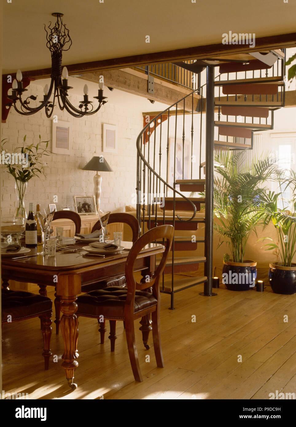 Victorian Table And Chairs In Dining Room With Modern Spiral Staircase Wooden Flooring