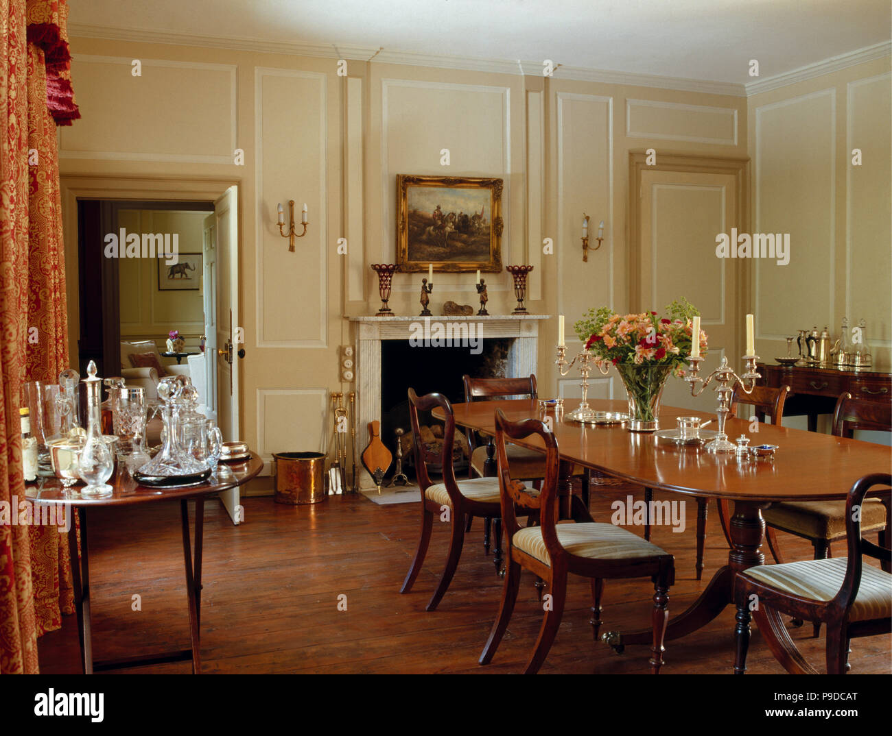 Regency Table And Chairs In Cream Panelled Dining Room With Wooden Flooring And Glasses And Decanters On Side Table Stock Photo Alamy