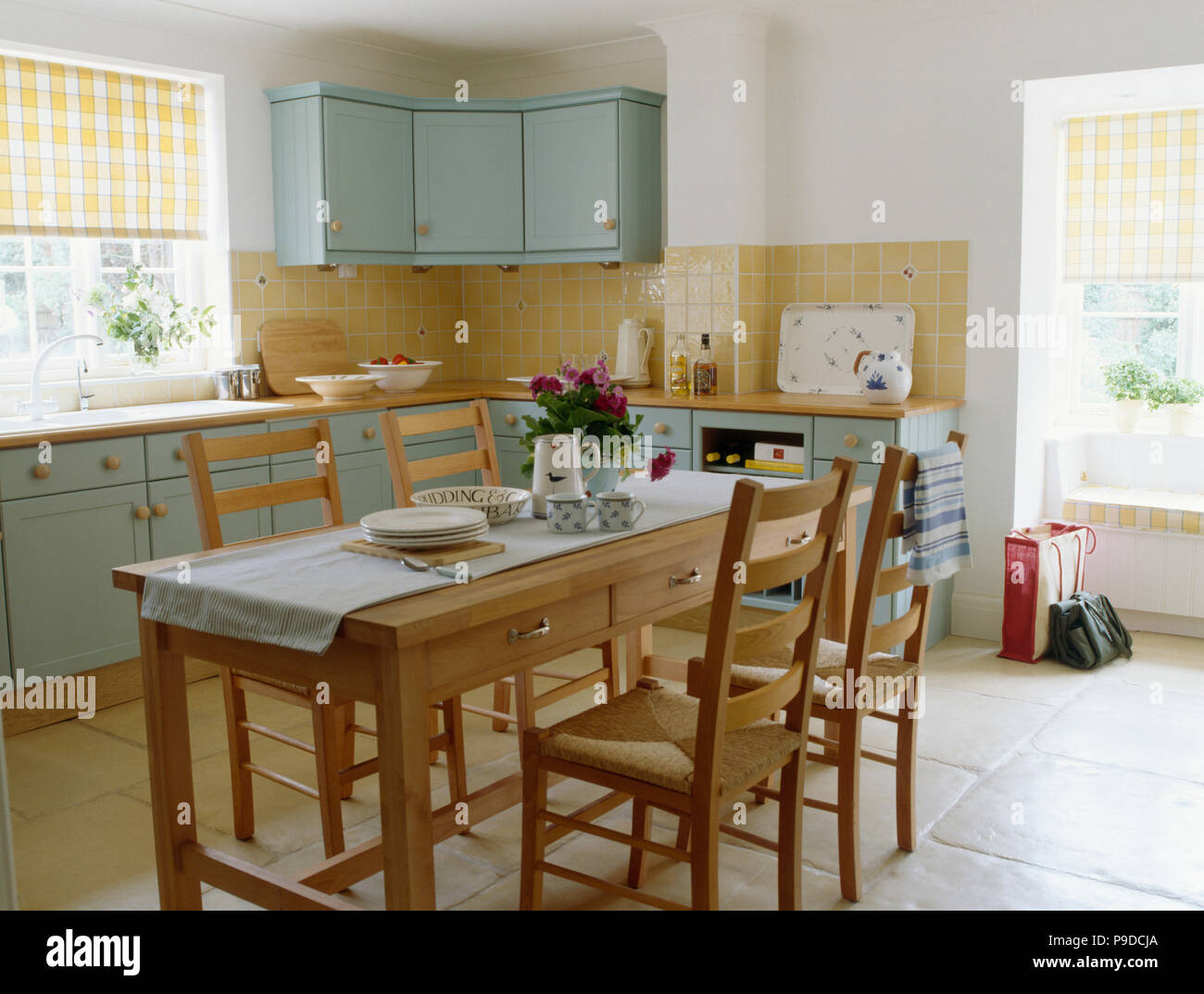 Simple Wooden Table And Chairs In Cottage Kitchen Dining Room With  Turquoise Units