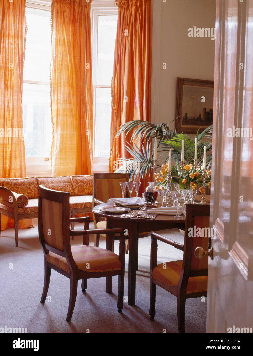 Orange Silk Curtains In Traditional Townhouse Dining Room Stock Photo Alamy