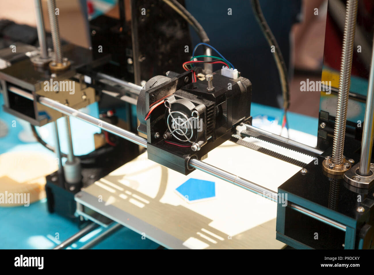 3d printer creating a new plastic object close up. 3