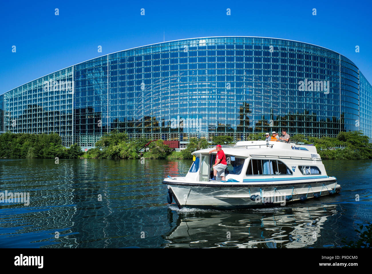 Strasbourg, pleasure boat cruising on Ill river, Louise Weiss building, European Parliament, Alsace, France, Europe, - Stock Image