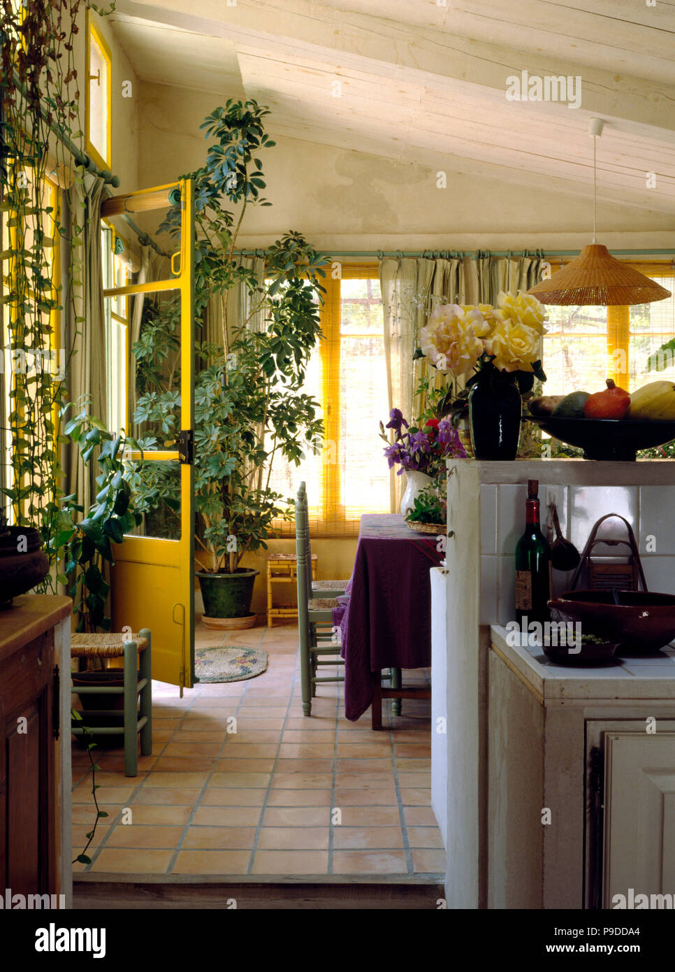 Terracotta Tiled Floor In A French Kitchen Dining Room With A Tall
