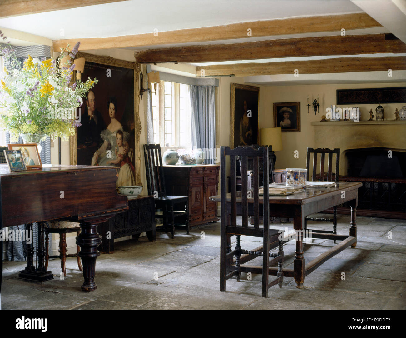 Antique Furniture And Piano In An Old Fashioned Dining Room With A Flag  Stone Floor