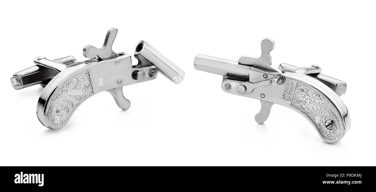 A pair of silver cufflinks that are working pistols firing blanks made by Maus of Germany - Stock Image