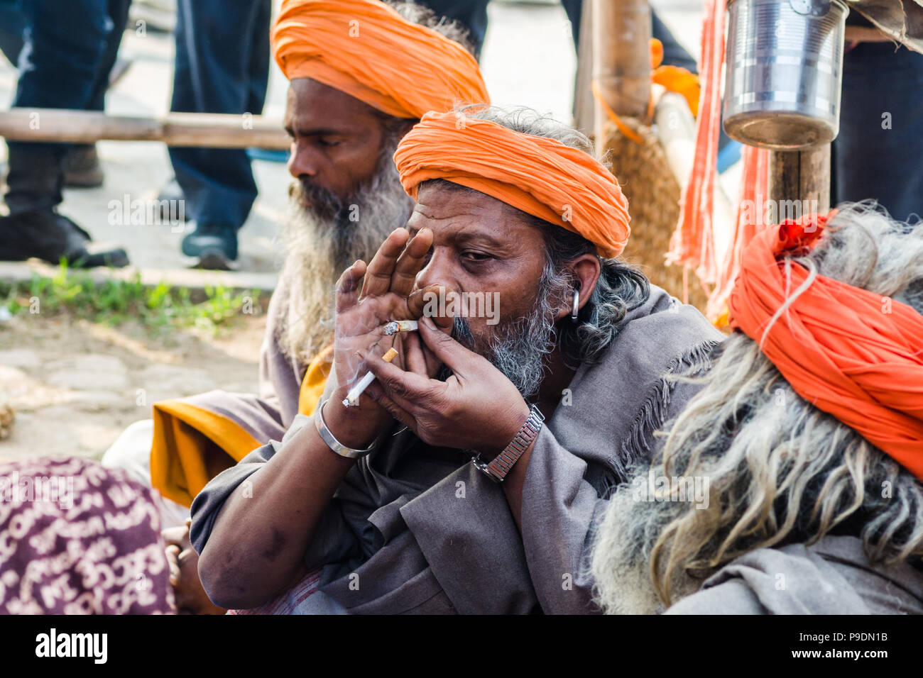 Sadhu smoking weed during Maha Shivaratri, Pashupatinath temple, Nepal - Stock Image