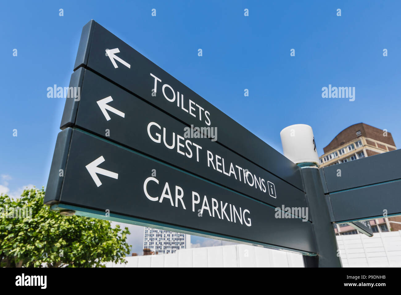 Public information sign in England, UK. Toilets sign. Guest relations sign. Car parking sign. Tourist information sign. Tourists information sign. - Stock Image