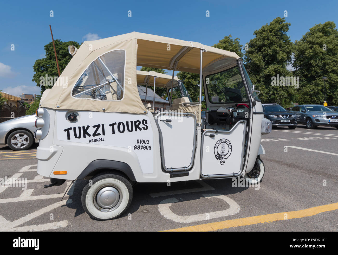 An empty white Piaggio Ape Calessino 3 wheeled cart (commonly known as a Tuk Tuk vehicle) from Tukzi Tours in Arundel, West Sussex, England, UK. - Stock Image