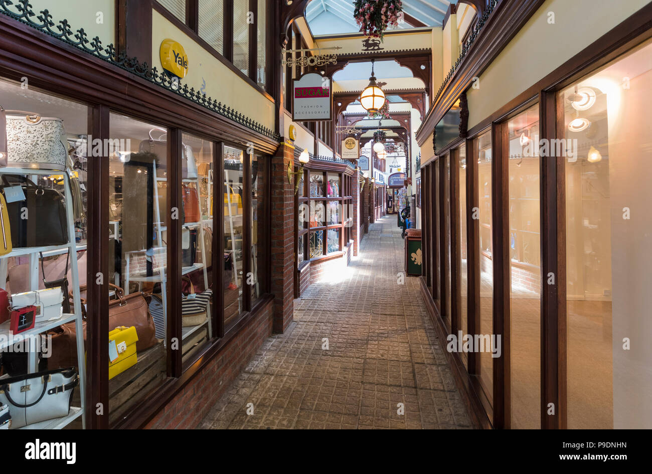 Interior of Arundel Shopping Arcade (AKA The Old Printing Works Arcade), a small historic British shopping mall in Arundel, West Sussex, UK. - Stock Image
