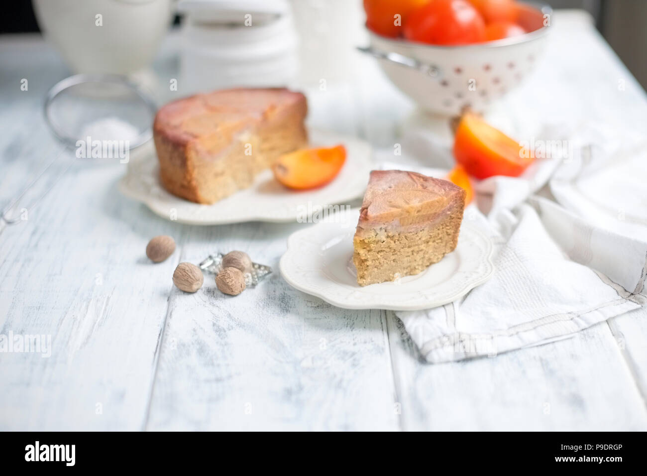 Homemade sweet pie with persimmon. Eastern sweets. Baking for breakfast. White background, free space for text or advertising - Stock Image