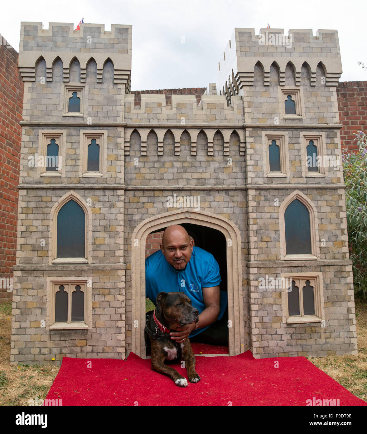 Craig Perera And His Dog Tyson Sit Inside A New Giant Pooch Palace Based On The Design Of Windsor Castle Which Has Been Given To Battersea Dogs Home In Old Windsor Berkshire
