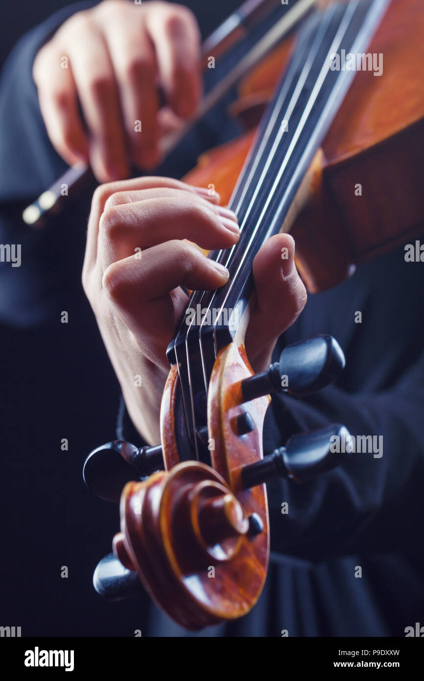 Playing the violin. Musical instrument with performer hands - Stock Image