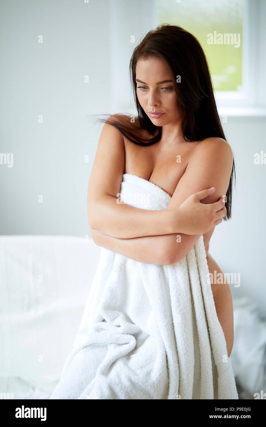 Sad looking woman wearing a towel - Stock Image