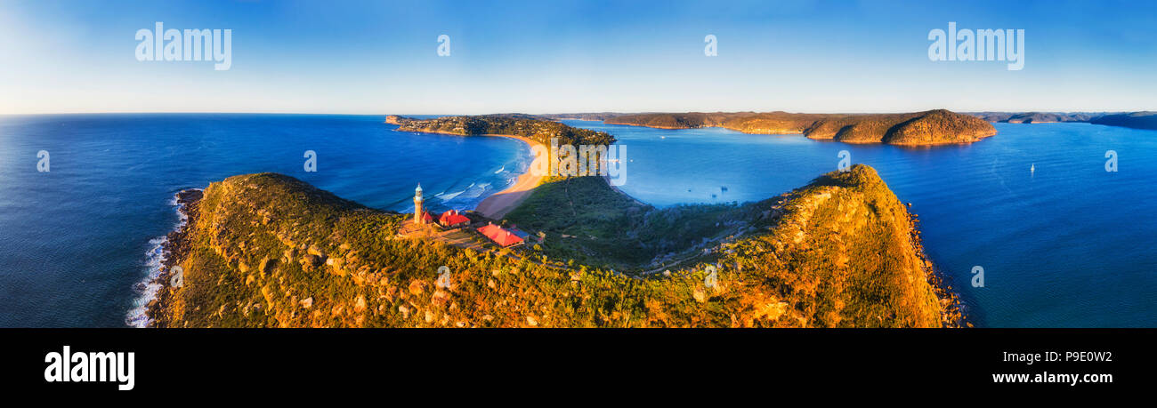 Barrenjoye head at the tip of Palm beach and Broken bay on Sydney northern beaches. Above elevated Lighthouse in wide aerial panorama. - Stock Image