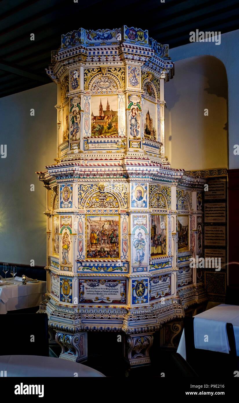 Basel, tiled ceramic stove 16th century in the Guild House Zunft zum Schlüssel, Schlusselzunft restaurant, Switzerland, Europe, - Stock Image