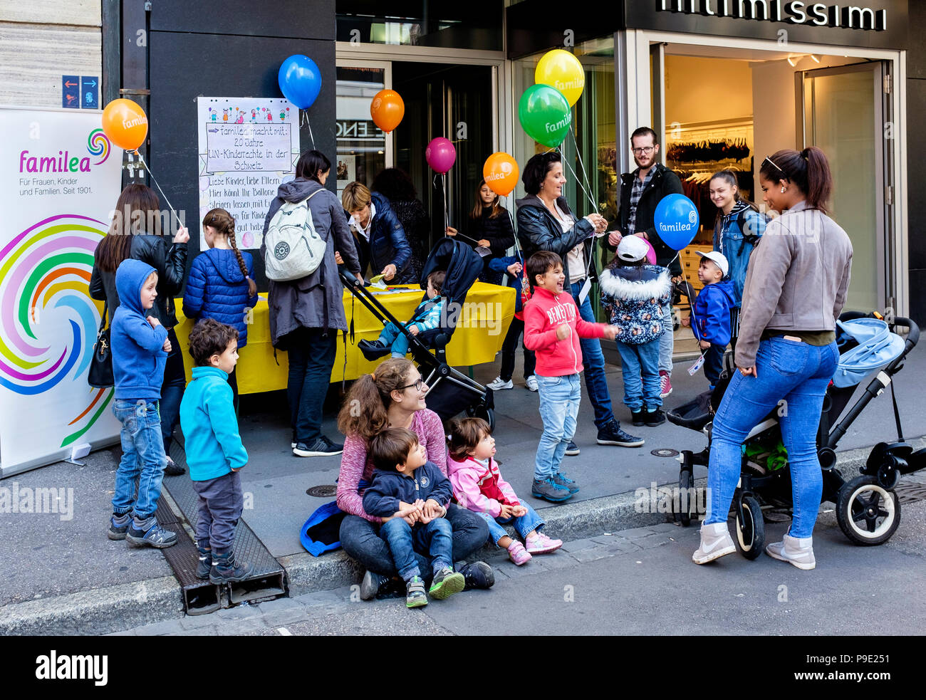 Basel, balloons charity sale on pavement, rising fund, funds,Familea child care center, parents and children, Switzerland, Europe, - Stock Image