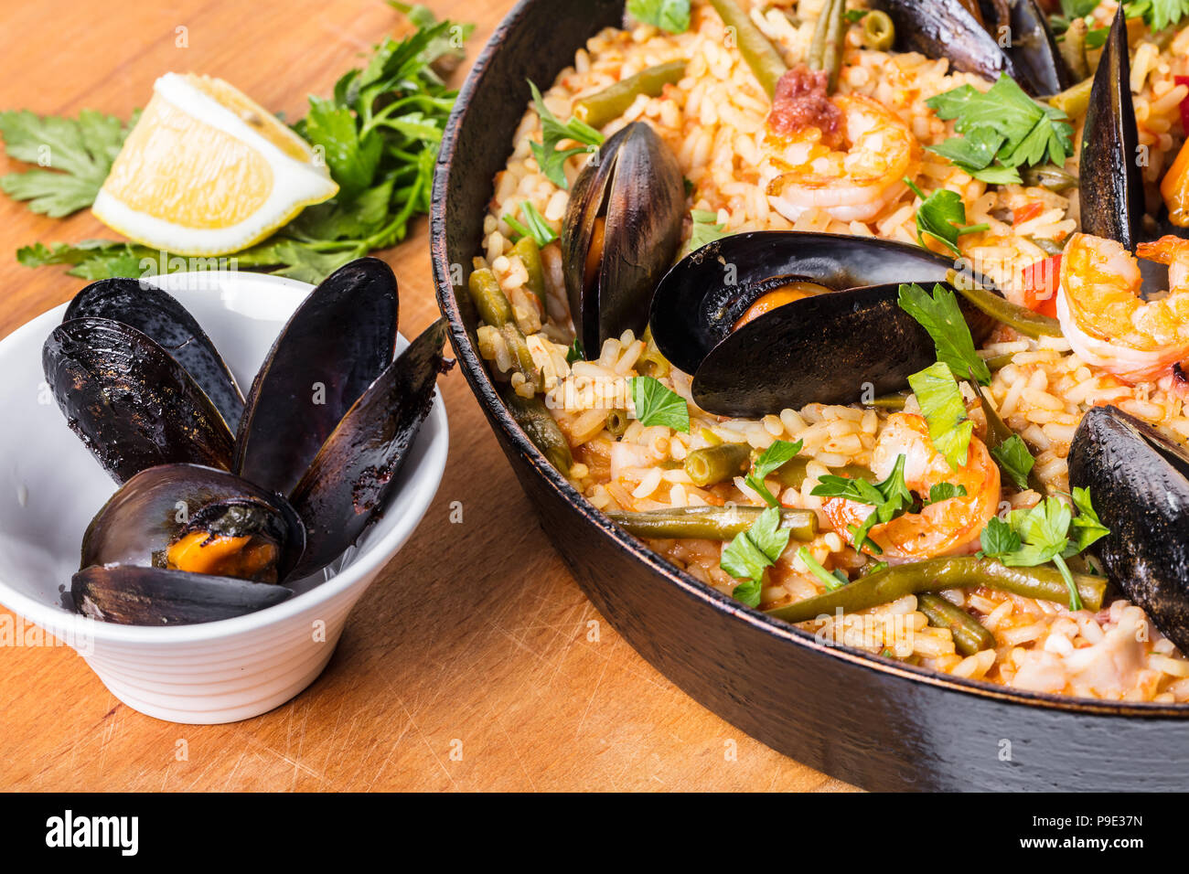 Spanish cuisine, paella with seafood and vegetables - Stock Image