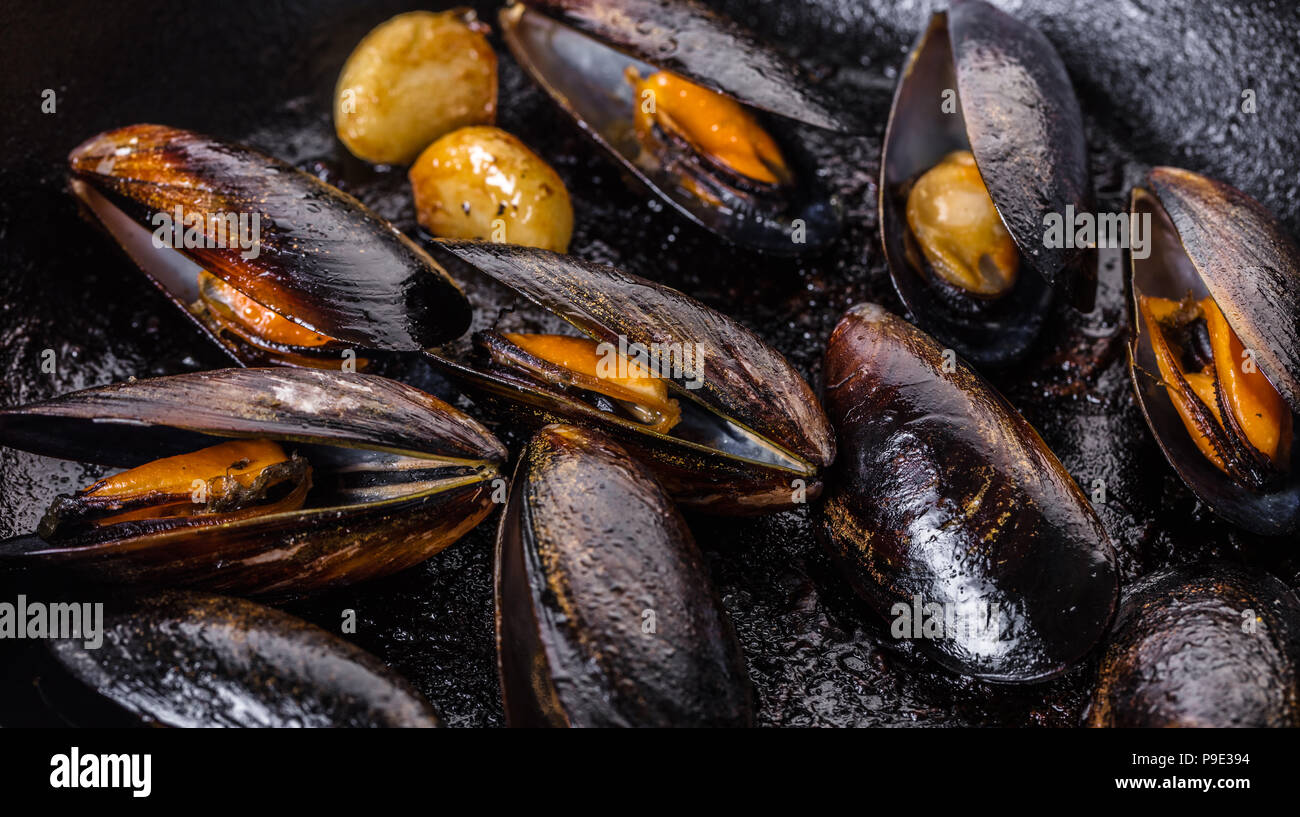 food background, texture of cooked mussels closeup - Stock Image