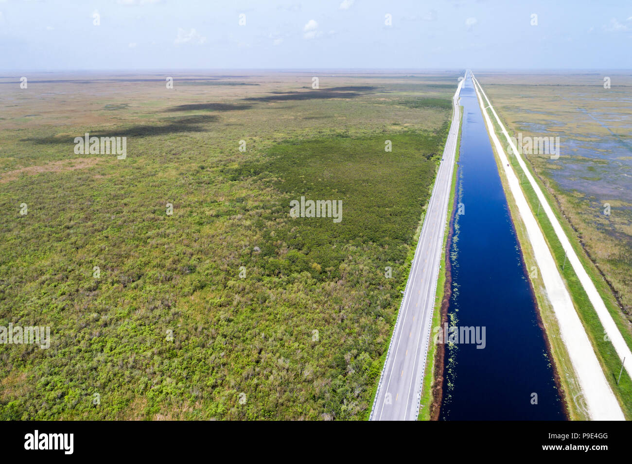 Miami Florida Everglades National Park Tamiami Trail US route 41 highway canal levee water conservation area 3A freshwater slough aerial overhead bird Stock Photo
