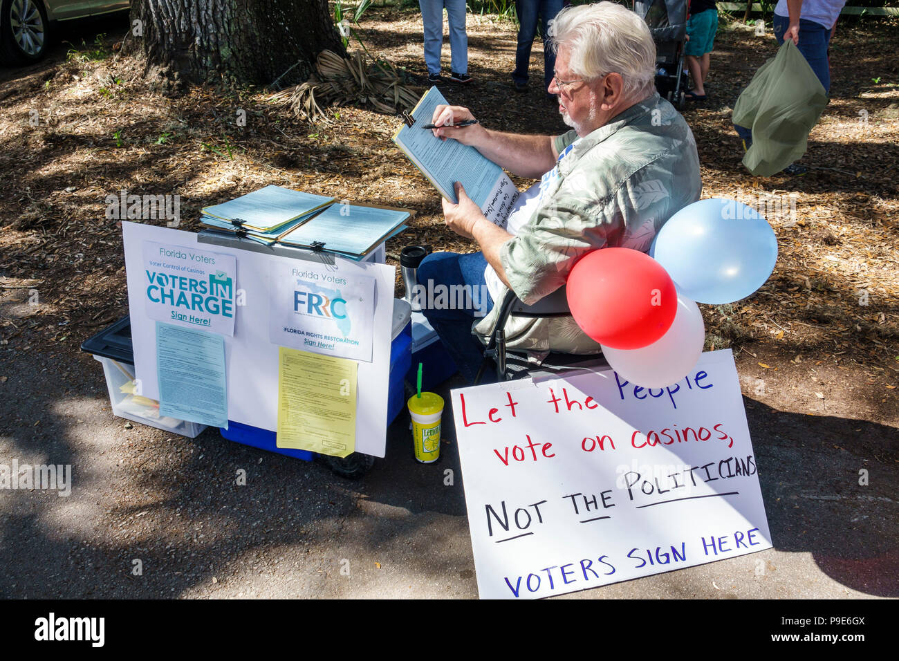 Florida Micanopy Fall Harvest Festival annual small town community event senior man seeking signatures voter petition casino gambling issue Voter Cont - Stock Image