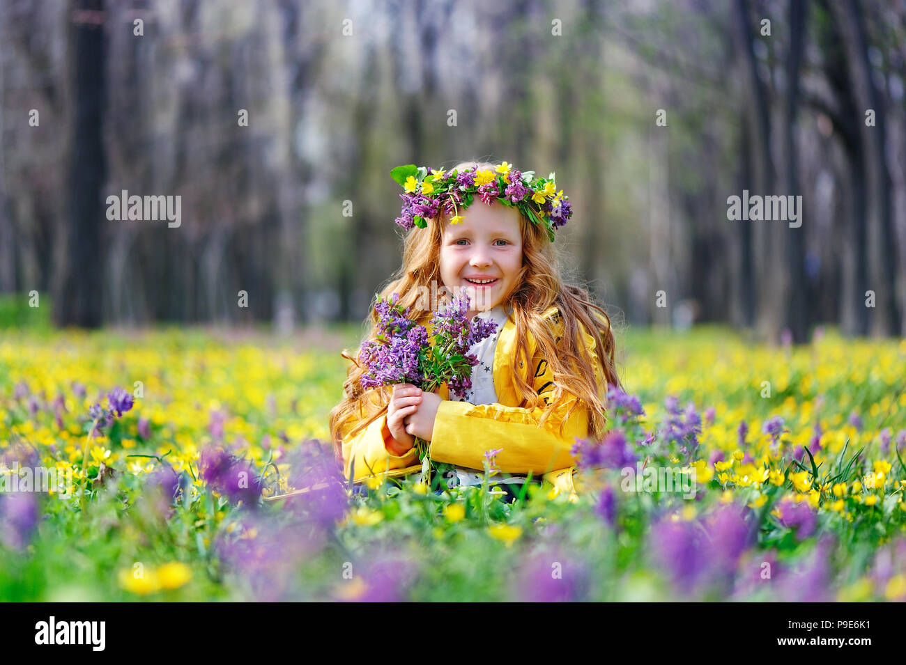 Little Girl In A Flower Headband With Flowers Bouquet Stock Photo