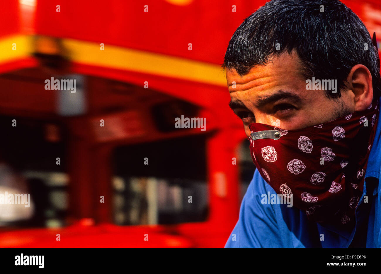 Cyclist in Face Mask, Cycling in Heavy Traffic, London, UK, GB. - Stock Image