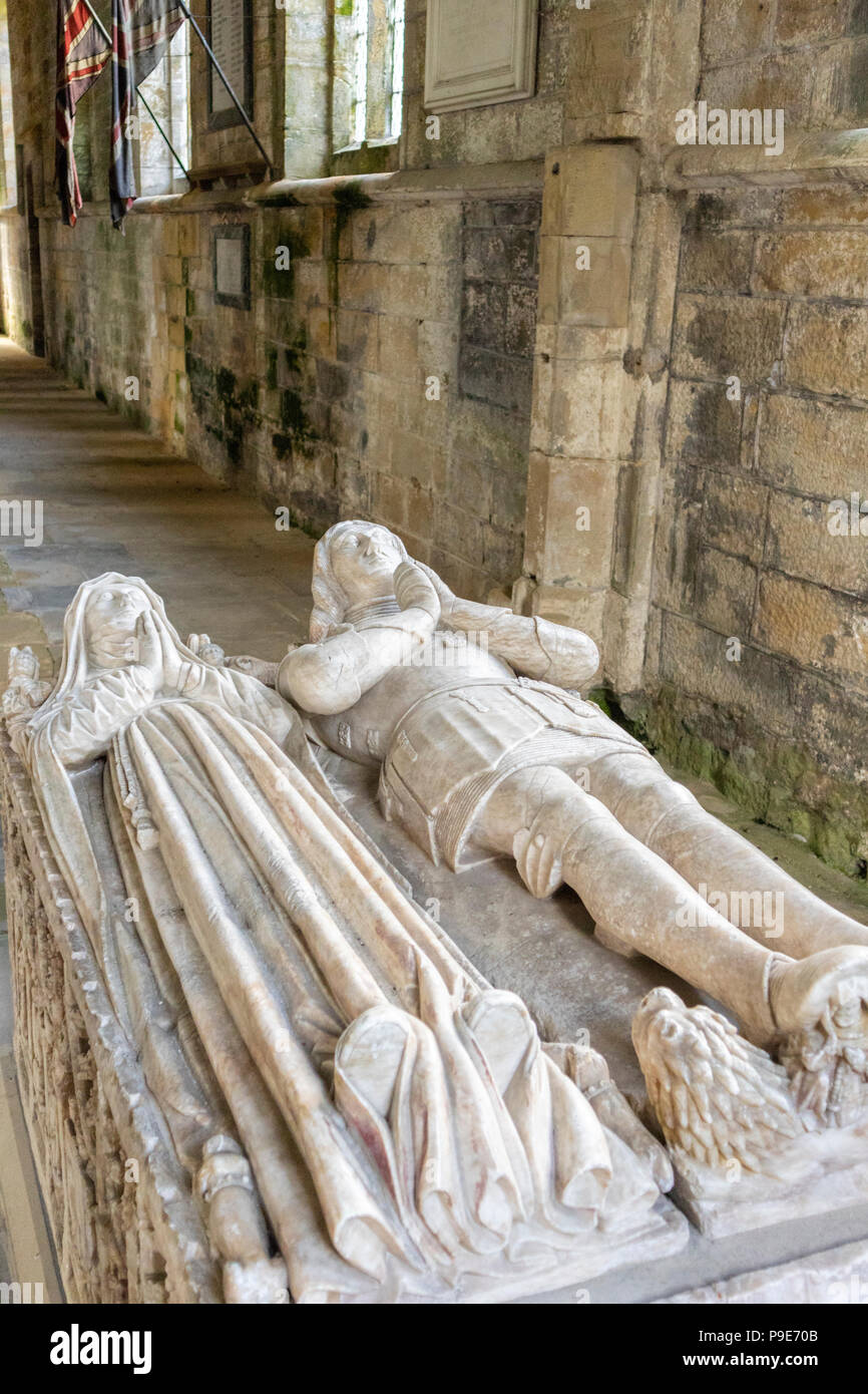 A tomb in All Saints Church in the park of Harewood House, Leeds, West Yorkshire UK - Stock Image