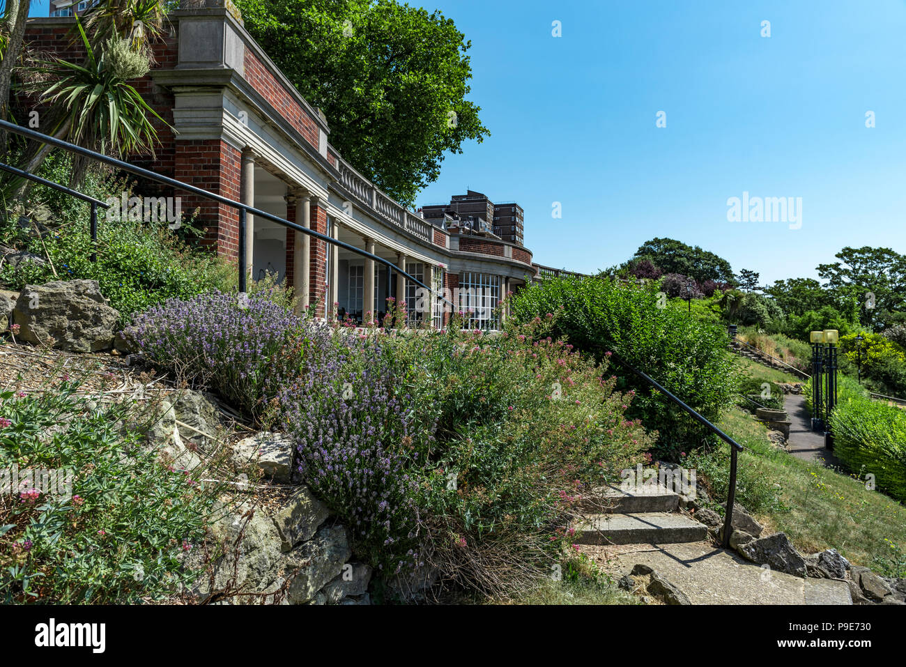 Large curved shelter in Southend on sea's Cliff Gardens,Situated beneath the Westcliff Hotel. - Stock Image