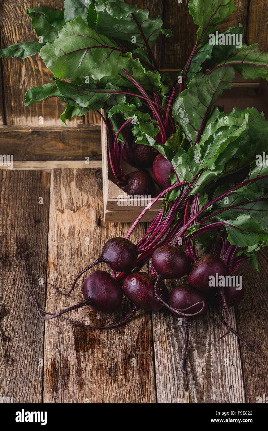 Fresh homegrown beetroots on wooden rustic table - Stock Image