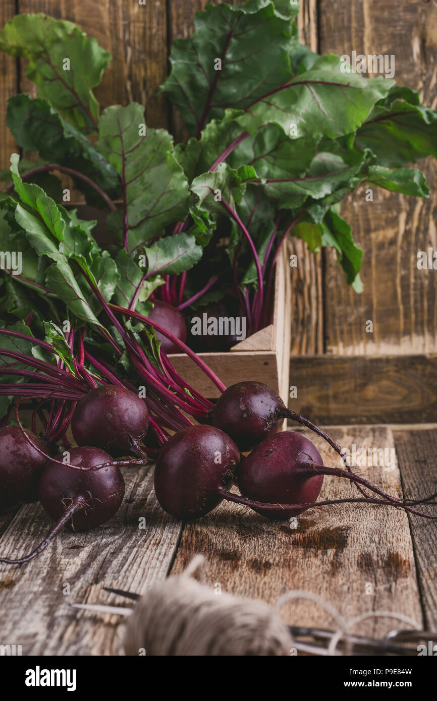 Fresh homegrown beetroots on wooden rustic table Stock Photo