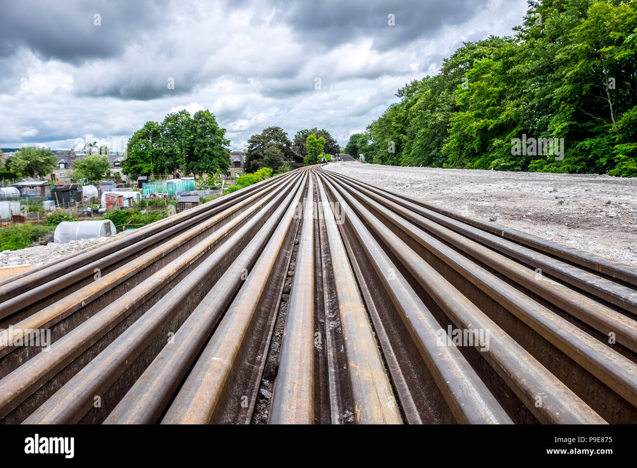 rail tracks disappearing into distance - Stock Image