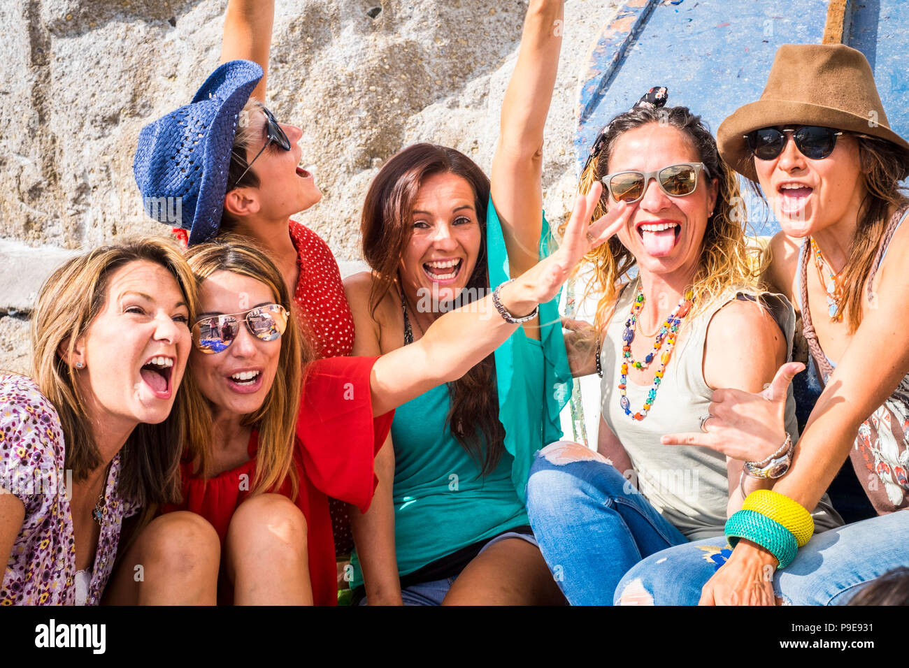 group of crazy nice beautiful caucasian girls outdoor under the summer sun doing a party all together. people having fun iall together oncept lifestyl - Stock Image