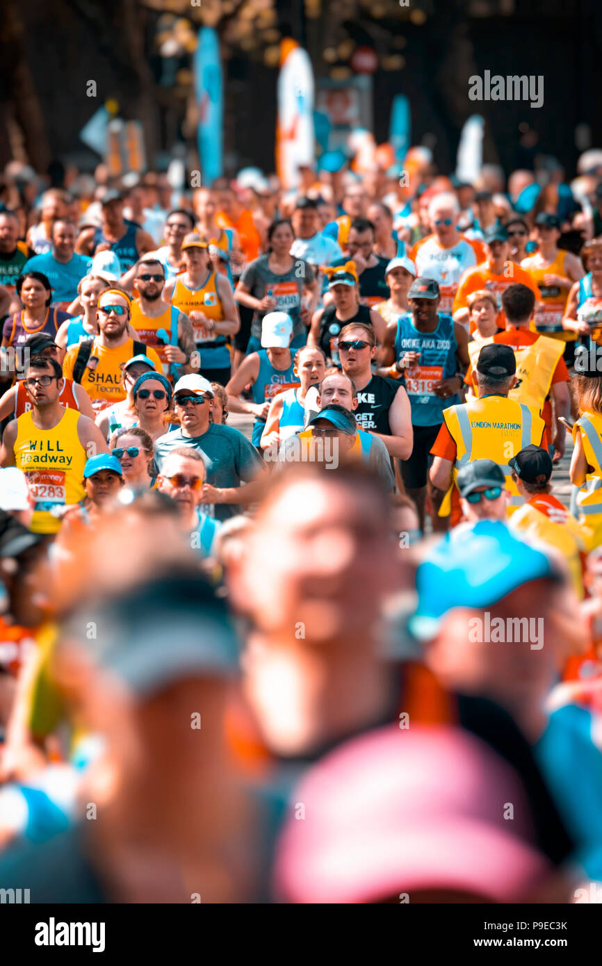 Runners taking part in the annual London Marathon, The first London Marathon was staged in 1981. - Stock Image