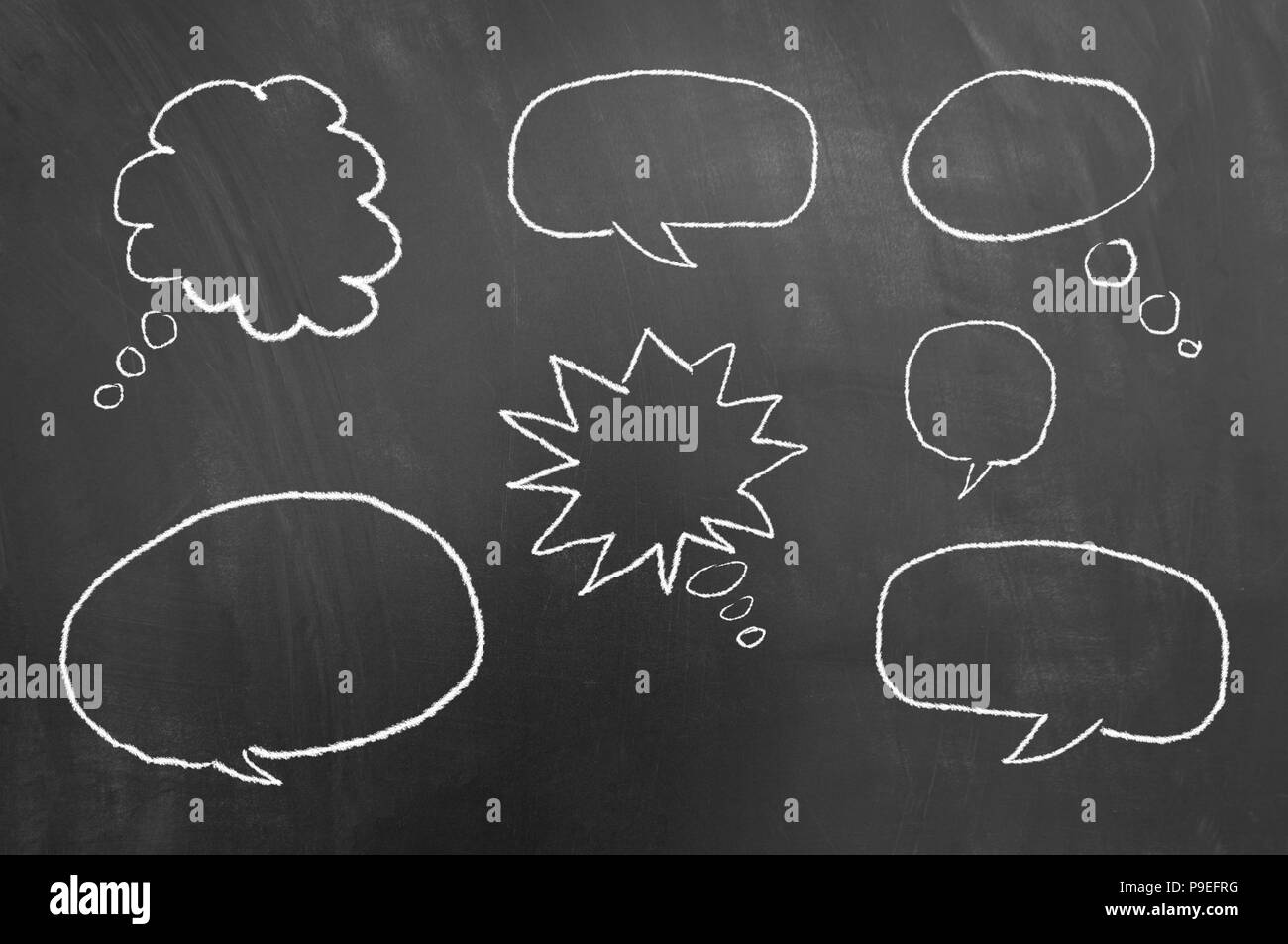 Multiple speech thought bubbles drawing on chalkboard or blackboard as communication balloon thought expression cloud concept - Stock Image