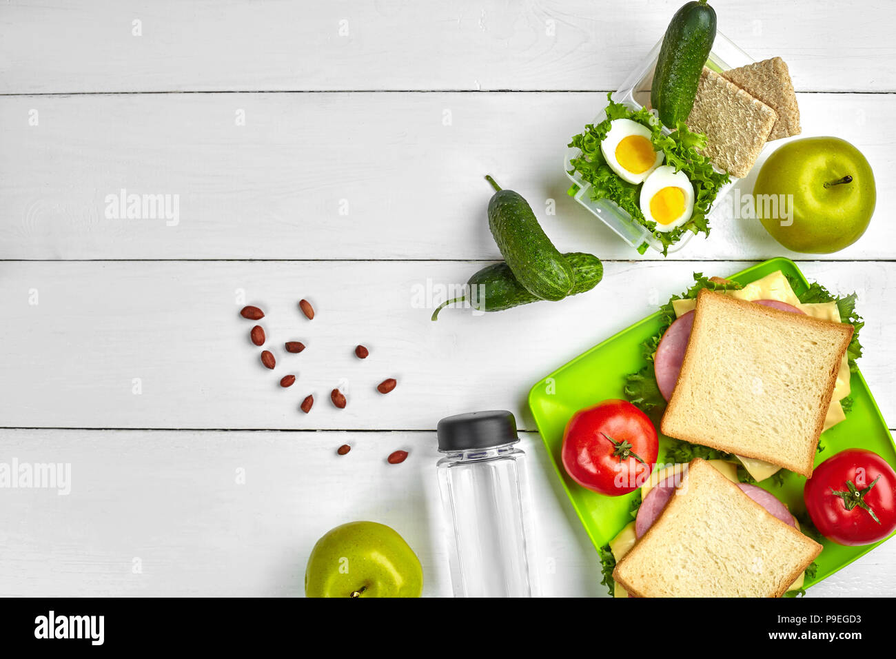 Lunch Sandwich And Fresh Vegetables Bottle Of Water Nuts And Fruits On White Wooden Background Healthy Eating Concept Top View With Copy Space Stock Photo Alamy Everyday, you'll have to make a decision about issues regarding environmental health, emission, etc. https www alamy com lunch sandwich and fresh vegetables bottle of water nuts and fruits on white wooden background healthy eating concept top view with copy space image212376559 html