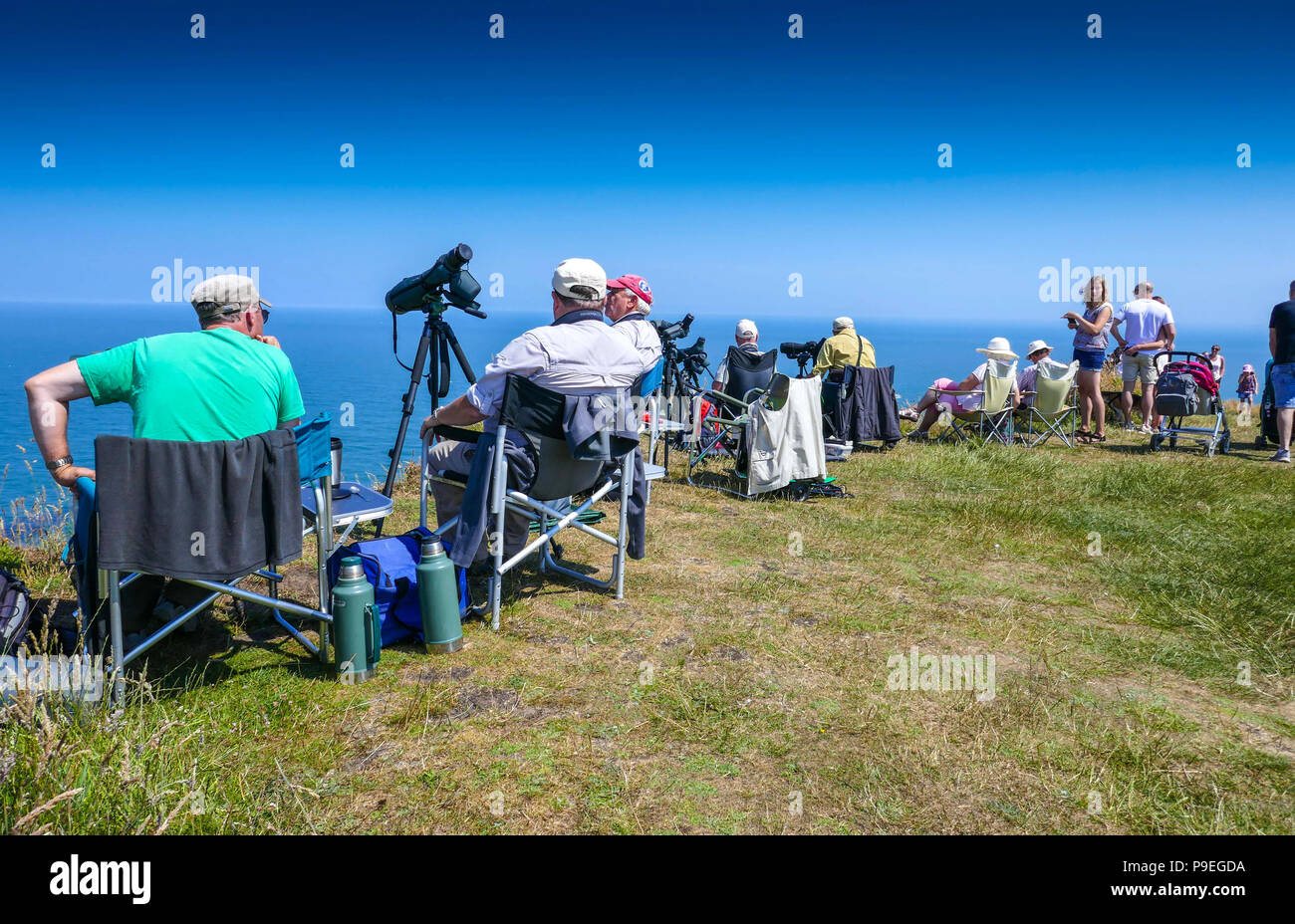 Bird watchers with telescopes and Summer weather at Flamborough Head, Easy Yorkshire - Stock Image